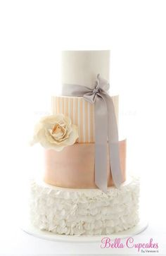 loving everything about this cake. stripes, solids, ruffles + the rose and bow. so cute!