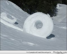 A snow roller in Cincinnati, Ohio, USA. A snow roller is a rare meteorological phenomenon in which large snowballs are formed naturally as chunks of snow are blown along the ground by wind, picking up material along the way, in much the same way that the large snowballs used in snowmen are made  15 Natural Phenomena You Won't Believe Are Real