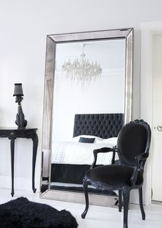 The French Bedroom Company Blog - Reflective Glory, looking at the perfect mirror for your home and bedroom from classical, french, gold ornate French mirrors to minimalist, modern, cool and clean lines. A beautiful monochrome bedroom with our Strictly Studded Floor Mirror and Sassy Boo Chair. Modern and stylish
