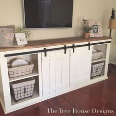 The talented just finished building this beautiful Sliding Barn Door Console. I had SO much fun painting and decorating! It will be headed to the this week. This piece can also be customized to any color and size preference. - October 19 2019 at Barn House Design, House Design, Barn Door Tv Stand, Home, Tree House Designs, New Homes, Farmhouse Tv Stand, Wooden Barn, Barn Door Console