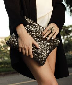 This is supposed to be some kind of fashion thing.. it just says to me.. OOPS.. I forgot my pants.. BUT LOOK I have a fab purse! Don't dress like a hooker...