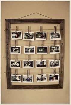display photos in old frame with clothes pegs and twine - display on other side of clothing stand, mirror stand, etc