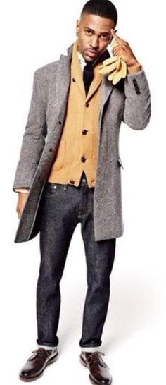 Grey Wool Tweed Coat, Tan Vicuña Cardigan, Dark Jeans, and Black Brogues. Men's Fall Winter Fashion, via GQ.