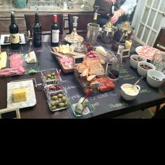 Wine, cheese, and chocolate party. Write the names on chalkboard paper. Wine or cheese that compliments the wine goes in front. Fun, creative idea Mrs. Rachel Fuhrman!