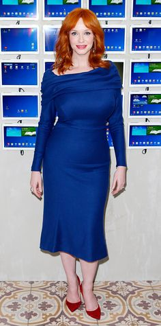 Christina Hendricks worked her curves in a skin-skimming deep cobalt blue Zac Posen dress with a slightly flared hem, accessorizing with Tacori jewelry and cherry red Jimmy Choo pumps.