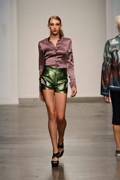 silk blouse and metallic leather hot pants with art deco patches