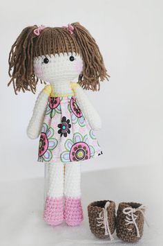 Handmade crochet doll with yellow, pink, and green outfit... and matching boots.