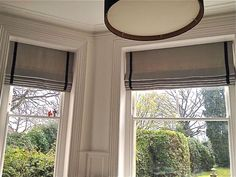 Cascade interlined linen roman blinds with contrast trim