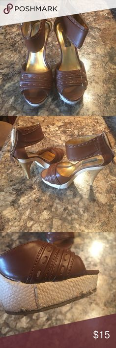 Brown heels Heels are size 6. Heels are brown and gold. Zips in the back. Heels goes round the the ankle. Have some small imperfections check pic 3&4. Has been worn but in good condition fabulosity Shoes Heels
