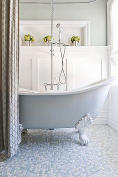 Painted-clawfoot-tub-and-mulitcolored-penny-flooring-give-this-bathroom-a-tranquil-vibe