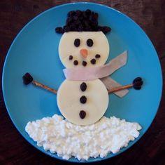 "Snowman = Cottage Cheese ""Snow"", Pretzel ""Arms"", Olives ""Hat"", Turkey & Cheese Tortilla ""Body"""