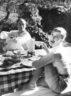 Audrey Hepburn and husband Mel Ferrer enjoying some tea, 1957