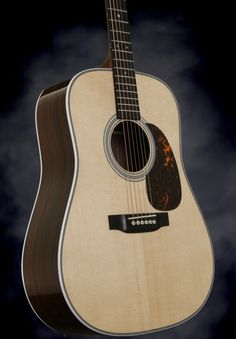 Martin HD-28 considered by many to be the best sounding of all Martin guitars. The HD-28 features includes a Sitka spruce top with East Indian rosewood back and sides,  classic herringbone inlay with the traditional zig-zag backstrip, and Martin's scalloped X-bracing. A classic to appreciate.