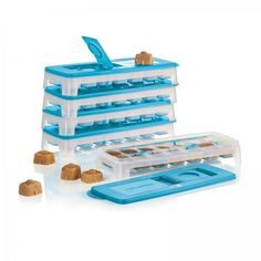 Tupperware Fresh & Pure™ Ice Tray - Set of 5:          One of our favorite products returns for a limited time. Freeze iced coffee, tea, fruit juices and more!   Set of five. Features a flexible bottom for easy ice cube removal. Hinged opening for mess-free filling. Just cover, fill to max line and freeze. Seal prevents spills and shields from freezer particles and odors. Dishwasher safe. Limited Lifetime Warranty.