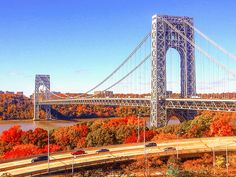 he George Washington Bridge spans through fall color. Kelly Kopp, Your Take National Weather, Hot And Humid, George Washington Bridge, Fall Photos, How To Raise Money, Where To Go, Travel Pictures, Places Ive Been, City