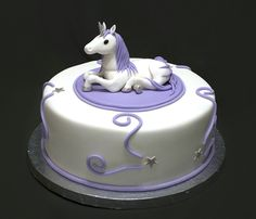 "Unicorn Birthday - Cake for an adult who loves unicorns. 10"" cake, topper is fondant."