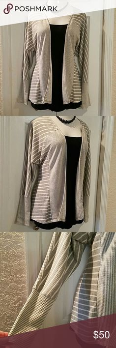 Grey fly away Cardigan plus size 14/16 Lane Bryant Offered is a stunning soft grey stripe and plaid fly away cardigan sweater. New with tags and in immaculate condition. Made by Lane Bryant. Plus size 14/16. Grey and white striped part is a ribbed knit and flyaway opening and hugger cuffs are plaid. Awesome layered over a black tank and skinny jeans with your favorite boots. Lane Bryant Sweaters Cardigans