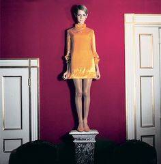 Twiggy photographed in a velvet orange mini dress by Cecil Beaton for Vogue, 1967