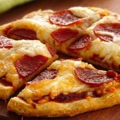 Pillsbury Grands mini pizzas! Make your own individual biscuit pizza in 25 minutes! Great idea for movie night!