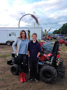 Victoria Leigh visits with Lane Duncan, after her National Anthem performance at the LSGTPA event during the Hunt County Fair. Garden Tractor Pulling, County Fair, National Anthem, Tractors, Baby Strollers, Monster Trucks, Victoria, Vehicles, Baby Prams