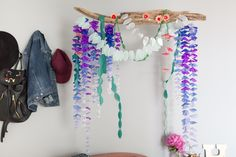 This DIY flower installation artwork is Isabelle's latest creation, tying her room together with purples and blues.