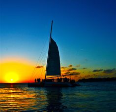 Finally decided to watch the sunset from the water this year. On our anniversary we will be sailing into the sunset on one of these catamarans. Can't wait !
