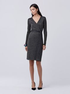 Understated and chic, this classic wrap dress shines in the metallic knit of the moment.