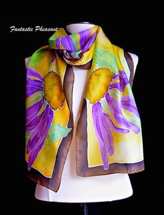 Each scarf in this shop is hand painted; each one is a unique piece of wearable art. I never use stencils, if a design Ive created becomes popular I may paint it again with different colors and a different layout so each scarf is unique. Silk scarves are the perfect accessories, they are jewels to add to your wardrobe. 100% natural silk scarf, 14 x 72 inches ( 35cm x 183cm) Hand rolled and hand sewn hems. Silk is soft and flowing with a beautiful drape. Hand painted with silk dyes and steam…