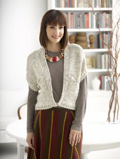 This simple knit vest is a lot more detailed than you think, look closer and it has a short row collar and bobbled trim.