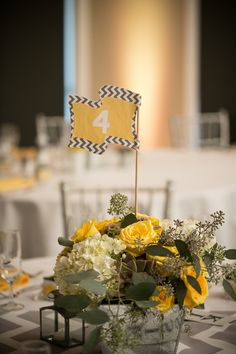 Grey and Yellow Centerpieces. #Chevron #TableNumbers #Grey #Yellow @GraniteBayGC Photo by: www.jacquelinephotography.net
