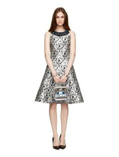 the super-classic pattern on this high-necked fit-and-flare dress is made modern thanks to the metallic thread therein; further embellishment comes in the form of a gem-encrusted collar. the result? a dress that requires almost nothing else to look done...just add heels and hit the town.