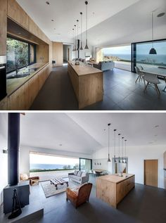 This kitchen brings nature inside with wooden cabinetry and a large window above the sink provides views of the plants outside. A large island with 5 simple pendant lights hanging above, is home to the cooktop and plenty of storage.