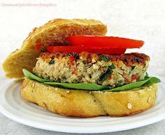 Pan-fried veggie burgers with cannellini beans, sauteed onions, roasted red peppers and baby spinach.