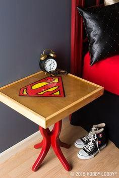 Learn how to transform a bland side table into a customized piece of art with help from a tin superhero sign and clear casting resin.