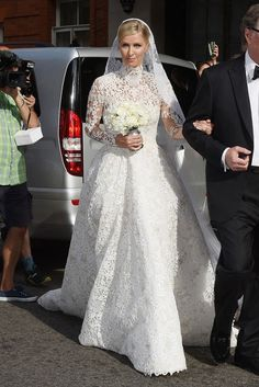 Nicky Hilton wears a custom Valentino Haute Couture lace wedding dress