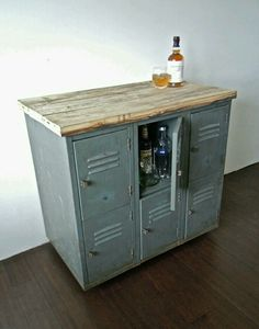 vintage metal lockers with reclaimed wood top on casters // industrial bar storage cabinet // kitchen island. Good idea for how I want to redo my old lockers/ how I want them to turn out Bar Storage Cabinet, Rustic Storage Cabinets, Locker Storage, Cabinet Ideas, Liquor Cabinet, Diy Storage, Storage Ideas, Alcohol Cabinet, Drinks Cabinet