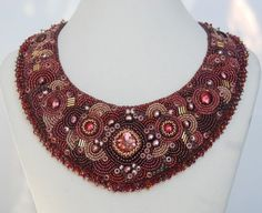 Stunning beaded collar/necklace. But can you imagine the time? Not to mention the weight to wear