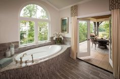 Open the French doors of the master bath to access the private, covered balcony…