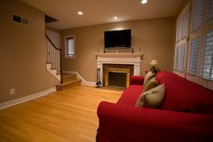 red couch with hardwood floors and wall color! Red Couch Rooms, Red Couches, Red Couch Living Room, Interior Decorating, Decorating Ideas, Decor Ideas, Interior Design, Living Room Hardwood Floors, Arlington Virginia