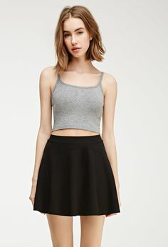$5, Black Skater Skirt: Forever 21 Classic Skater Skirt. Sold by Forever 21. Click for more info: https://lookastic.com/women/shop_items/293094/redirect