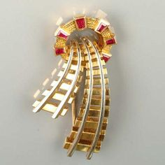 A gold and ruby 'tunnel' clip, by Van Cleef & Arpels, circa 1952