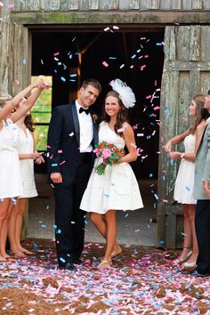Confetti wedding exit, fun bright colors. I hate wedding that use bird seed or rice who wants that thrown at them???