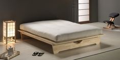 Mori. Made of solid hevea wood varnished in natural colour, with a slat bed base also made of solid hevea wood. It has a reclining headboard. Under the bed, there is room for up to four drawers (sold separately).