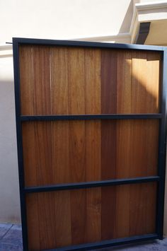 Black Steel Frame with Vertical Stained Boards