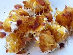 Cheesy Ranch Tater Tots   -   1 bag frozen tater tots (or french fries)  Sour Cream Ranch Sauce  1 cup sour cream  1/2 cup ranch dressing  1/4 cup milk  Toppings  1 cup Shredded cheddar cheese  1/2 cup shredded mozzarella cheese  1/2 cup real bacon bits  1/4 cup green onions
