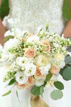 Ultra Elegant Bridal Bouquet Showcasing: White Sweet Pea, White English Garden Roses, White Lisianthus, White Lilac, Peach Roses & Silver Dollar Eucalyptus