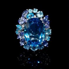 Diamond, Blue Sapphire, Tanzanite and Blue Topaz 18k White Gold Ring