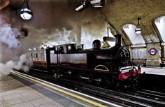 A restored original locomotive hauls a Victorian first-class carriage through Baker Street station in a test run for London Underground's 150-year anniversary celebrations -  click for article and more pictures.
