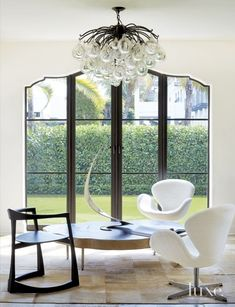 Transitional White Sitting Area with Curved Doors