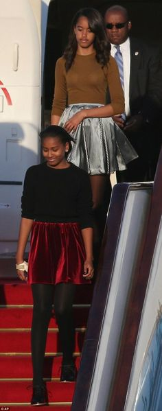 Sasha and Malia step off the plane as part of their visit to Beijing, China in March 2014.